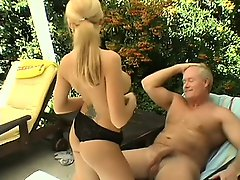 Desirable blonde with big tits has a horny old man drilling her peach